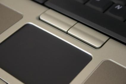 Slik deaktiverer en Touchpad når du bruker en mus